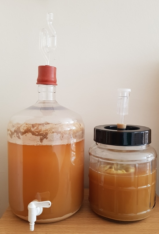 two fermenters with airlocks